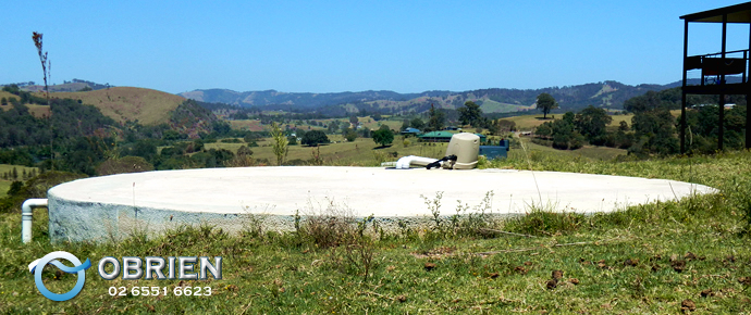 Below ground concrete water tank on sloping site near small acreage property (Gloucester Region)